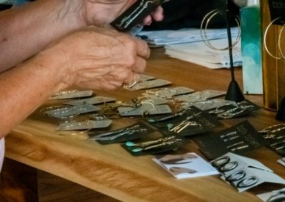 visitors find earrings at steppin out in Taos